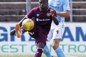 Hearts' Danny Amankwaa holds off Andy Munro. Photograph: Bruce White