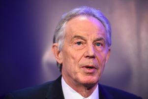 Tony Blair has called on Remainers and Brexiteers to come together to defeat Theresa May's plan for leaving the European Union.