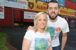 Siobhan Cunning and Chris Sayles, both 37, walked to all 42 Scottish football stadiums, raising a whopping �15,000 for charity along the way. Picture: SWNS