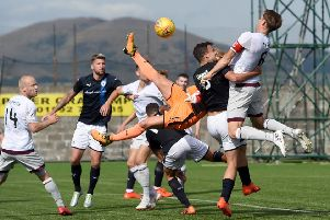 Christophe Berra rises to head the ball into the back of the net but the goal was disallowed. Picture: SNS.