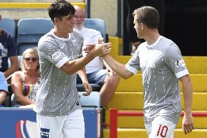 Dunfermline's Jackson Longridge celebrates his goal at Dundee with brother Louis. Picture: Rob Casey/SNS