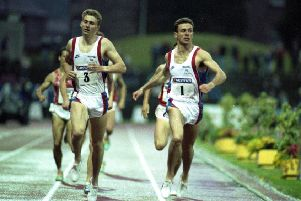 Brian Whittle, wearing number three, crosses the finish line with Tom McKean at Meadowbank stadium in 1991. Picture: Graeme Hunter
