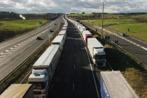 Lorries parked on the M20 in Ashford, Kent, as fresh fears over the impact of a no-deal Brexit have been raised regarding how Channel ports will cope with lorry backlogs. PRESS ASSOCIATION Photo. Issue date: Tuesday July 31, 2018. See PA story POLITICS Brexit Ports. Photo credit should read: Gareth Fuller/PA Wire