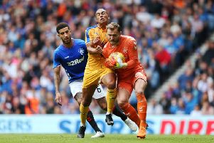 Rangers goalkeeper Jak Alnwick smothers the ball during Sunday's friendly victory over Wigan at Ibrox. Picture: PA.