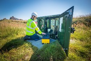 BT Openreach engineer Stuart MacDonald in North Tolsta, a remote community in the Western Isles which was among the first in Scotland to test increased broadband speeds over long phone lines. Picture: PA