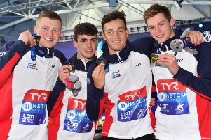 Britain's Adam Peaty, Nicholas Pyle, James Guy and Duncan Scott celebrate their victory in the men's 4x100m medley. Picture: Bill Murray/SNS