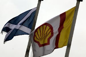 Flags fly outside the Shell Exploration and Production offices in Aberdeen. The company has marked 50 years of production in the North Sea energy sector. Picture: PA
