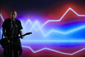 Chris Thorpe uses a well-amplified guitar to blast out his anger with contemporary life. Picture: Contributed