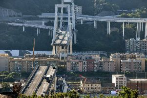 The collapse, which saw a vast stretch of the A10 freeway tumble on to railway lines in the northern port city, was the deadliest bridge failure in Italy for years, and the country's deputy transport minister warned the death toll could climb further. Picture: AFP/Getty