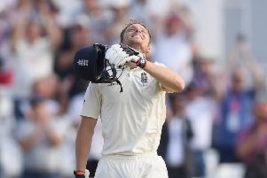 Jos Buttler celebrates after reaching his century. Picture: Stu Forster/Getty