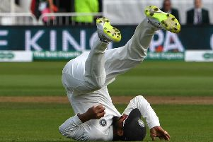 India's Ajinkya Rahane tumbles backwards after catching James Anderson in the slips. Picture: Paul Ellis/AFP/Getty