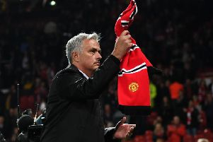 Jose Mourinho waves a Manchester United scarf towards fans after his side's 3-0 defeat by Tottenham Hotspur at Old Trafford. Picture: Michael Regan/Getty