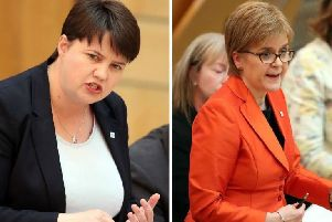 Ruth Davidson (L) has urged Nicola Sturgeon (R) to rule out holding a second Scottish independence referendum. Picture: PA Wire