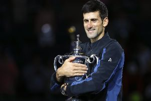 Novak Djokovic holds the US Open trophy after defeating Juan Martin del Potro in the final. Picture: AP Photo/Adam Hunger