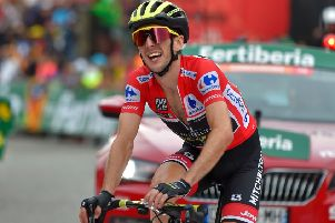"""Simon Yates crosses the finish line of the 20th stage of the 73rd edition of """"La Vuelta"""". Pic: Ander Gillenea/AFP/Getty Images"""
