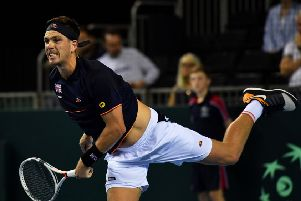 British No 2 Cameron Norrie serves on his way to beating Sanjar Fayziev and securing Davis Cup victory over Uzbekistan in Glasgow. Picture: Bill Murray/SNS