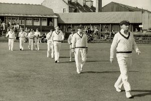Don Bradman leads the Australian team out at Mannofield, Aberdeen. Picture: Herald & Times Archive