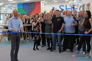 Chief executive Matthew Elson and the SHE Software team celebrate the opening of the new East Kilbride office. Picture: Contributed