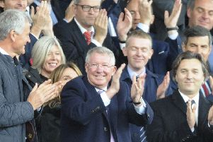 Former Manchester United manager Alex Ferguson applauds as he takes his seat on the stands before the English Premier League soccer match between Manchester United and Wolverhampton Wanderers. Picture; AP