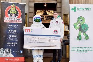 The winner of the Autumn 2018 Innovator Launchpad Michael Harkins is presented with his cheque. Picture: TSPL