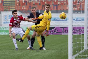 Dundee's Andy Boyle heads in the opener. Pic: SNS/Bill Murray