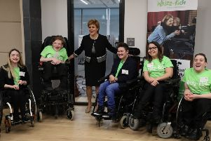 Nicola Sturgeon, the First Minister of Scotland alongside l-r Caitlyn Fulton,Joshua Millar,First Minister Nicola Sturgeon, Rian Hiney, Natalie Bell and Harry Stratton at the launch in Edinburgh of Wheeling for Change. Picture: PA