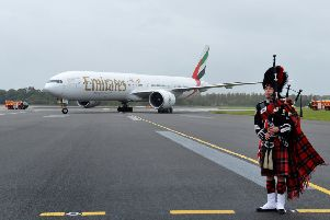 An Emirates Boeing 777-300ER is met by a piper at Edinburgh Airport. Picture: PA