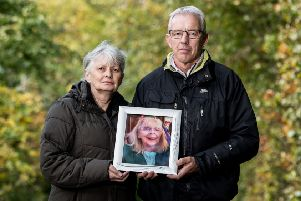 Gerald McNally and his sister Margaret Milne hold a photo of their late mum, Margaret McNally.