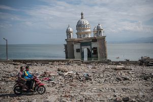 The Earthquake and tsunami in Indonesia has killed over 1,500. (Photo by Carl Court/Getty Images)
