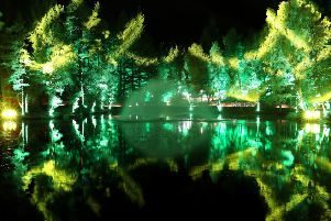 Trees are reflected in Loch Dunmore at The Enchanted Forest sound and light festival in Faskally Wood in Pitlochry. Picture: Andrew Milligan/PA Wire.