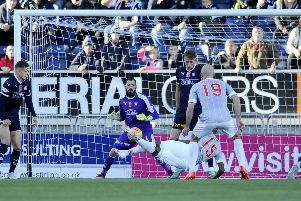 Myles Hippolyte shot saved on to the bar by Leo Fasan. Pic: Michael Gillen