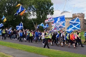 Indy supporters march on the Scottish Parliament on the anniversary of the independence referendum. Picture: Steven Scott Taylor / J P License