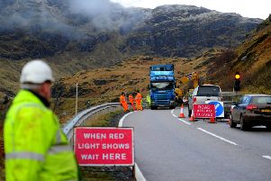 Landslide at the Rest and be Thankful. Workers clear the mud from the A83. Picture: TSPL