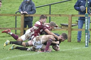 Currie Chieftains' Scott McGinley powers over for a second half try despite some close attention. Photograph: Neil Hanna    Picture: Neil Hanna