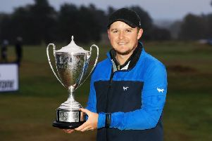 Eddie Pepperell shows off his trophy after winning the British Masters. Picture: Getty
