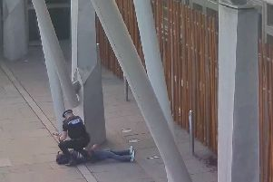 Two videos show Swiatek being challenged by a police officer and being disarmed of his knife