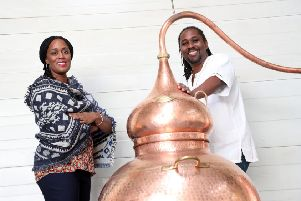 Chief executive Jacine Rutasikwa and master distiller Paul Rutasikwa at their rum distillery in Livingston. Picture: Stewart Attwood