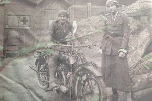 Trilby on a motorcyle with a fellow volunteer near the Front