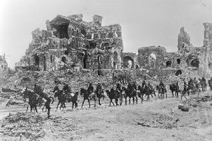 22nd August 1918:  The British Cavalry passing the remains of Albert Cathedral, after the 2nd Battle of the Somme.  (Photo by Hulton Archive/Getty Images)