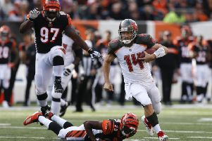 The electrifying Ryan Fitzpatrick gave Cincinnati Bengals a scare by hauling the Buccaneers level. Picture: AP.
