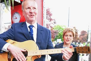 Nicola Sturgeon listens to SNP MP Pete Wishart play guitar, but will she listen to him about the People's Vote Brexit campaign? (Picture: Jeff J Mitchell/Getty)