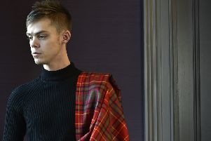 Ellis Urquhart, tourism lecturer at Edinburgh Napier University, is the first to wear the Scotland's War tartan.