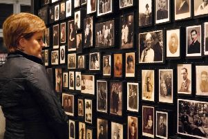 Nicola Sturgeon views photographs of victims of the Holocaust during her visit to the Auschwitz-Birkenau camp