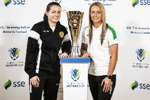 Suzanne Mulvey of Motherwell and Joelle Murray of Hibs with the new Scottish Women's Cup. Ella Sharp designed the trophy. Picture: Roddy Scott