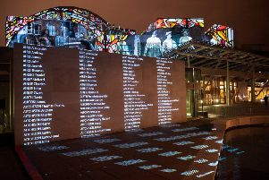 Names of WW1 fallen illuminate Scottish Parliament