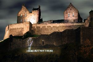 A silhouette of a First World War Tommy projected on to Edinburgh Castle. Picture: PA Wire