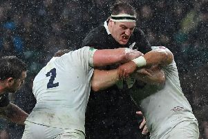 New Zealand lock Brodie Retallick is stopped in his tracks by England at Twickenham. Picture: Ben Stansall/AFP/Getty Images