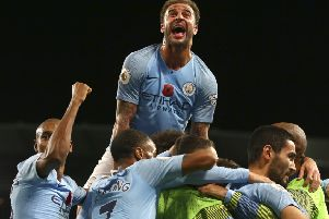 Manchester City's Kyle Walker, top, celebrates after Ilkay Gundogan scored his side's third goal in the 3-1 win over Manchester United. Picture: Dave Thompson/AP