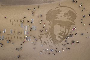 A sand drawing on Ayr Beach of Second Lieutenant Walter Tull, who was Britain's second black professional footballer who had signed up with Rangers, and the first black officer in the British Army. Picture: SWNS