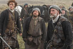 The Fraser clan's tartan are dark in colour to reflect the dirty environment the characters live in